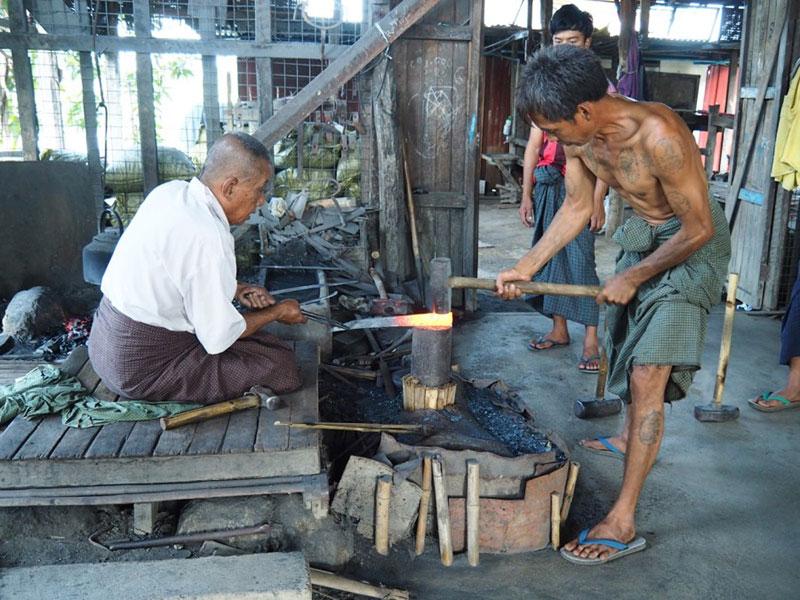 Sculptor molding the iron